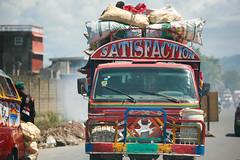 I get no... (Alex E. Proimos) Tags: road bus car danger truck haiti dangerous driving pollution satisfaction haitian overloading haitien