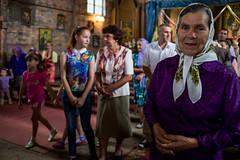 . (www.piotrowskipawel.pl) Tags: stoyantsi lvivoblast ukraine documentary documentaryphotography reportage photojournalism religion faith church catholic mass faithful woman oldwoman girl women pawepiotrowski piotrowskipawelpl decisivemoment portrait