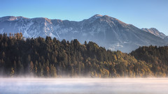 Misty Morning Alps (TheFella) Tags: morning travel trees mist mountain lake mountains alps tree slr water misty fog skyline digital photoshop sunrise canon landscape eos dawn photo high europe day dynamic hill foggy peak hills slovenia photograph processing bled 5d daytime dslr range hdr highdynamicrange mkii markii postprocessing lakebled travelphotography julianalps photomatix thefella 5dmarkii conormacneill the