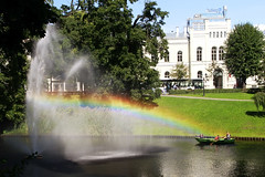 Rainbow in Riga (Martins Skujans) Tags: travel blue light shadow sky people urban sun house colour reflection building tree green water fountain grass composition swim canon garden fun boat town rainbow bush focus raw day afternoon view bright turquoise group lawn tourist latvia beam form colourful shape jpeg channel riga imagery canoneos600d martinsskujans