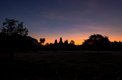 Divine silhouette (Jonas Hansel) Tags: morning red sky sun tree tower monument silhouette digital sunrise canon geotagged temple eos rebel kiss cambodge cambodia kambodscha khmer cloudy famous angkorwat icon structure palm angkor tamron sonne iconic sonnenaufgang zon 2012 zonsopgang cambodja t3i x5 kampuchea 600d 18270 tamron18270 canonrebelt3i canonkissx5