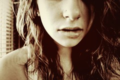 Fear. (FadedKate) Tags: pierced woman white girl beautiful beauty face sepia hair natural fear longhair curls lips piercing bite strong tones forget