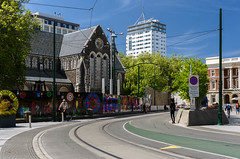Waiting (Jocey K) Tags: trees newzealand christchurch sky people signs church architecture clouds buildings tramlines earthquakedamagedchristchurchcathedral cathdedralsq