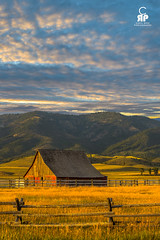 Swan Valley Sunset (Chris Ross Photography) Tags: d800 nikon wyoming sunset barn red wheat field fence side light mountain green pine cascade idaho clouds orange blue