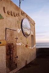 At the beach_35mm_FILM (Arranion) Tags: canon eos 300 35mm film ocean beach blaauwberg texture door architecture kodak colorplus iso200