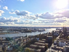 On the St. Michael's Church - the view is to the southwest onto the second largest port in Europe. (arwed.kubisch1) Tags: hamburg hansestadt hanseatic river flus fluss elbe cloudy clouds sunny sun wolkig wolken sonnig sonne city metropolis habour hafen port michel kirche church