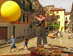 village festival (ludi_ste) Tags: balloon ball kids stilts stiltsman village old books libri funambolo bambini children