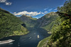 A glorious morning in Geiranger! (wimvandemeerendonk, back in the cold brrrrr!) Tags: green clouds cloud cloudscape forest geirangerfjord geiranger hill hills landscape mountain mountainscape nature outdoors outdoor panorama rock rocks sony sky snow tree trees norway wimvandem mountainside ship ships cruising sun scenic fjord bright blue contrast color colors colours colour falls heaven icefield minolta valley water golddragon 200249faves