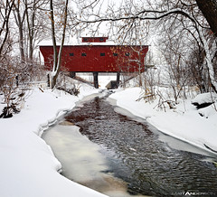 A Red Wooden Bridge near Milton Janesville Wisconsin in Rock County at Winter with snow and ice near a stream (Matt Anderson Photography) Tags: county wood bridge winter red usa white snow color colour building tree art fall ice nature beauty leaves rock horizontal wisconsin matt landscape outdoors photography frozen cool midwest colorful stream gallery day seasons artistic colorfull room fineart hill seasonal fine scenic overcast nopeople panoramic anderson coveredbridge remote flowing milton hdr scenics janesville traditionalculture tranquilscene traveldestinations colorimage nonurbanscene coldtemperature forcopy mattandersonphotography
