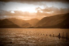 Derwent Water at Keswick (Tony Worrall Foto) Tags: wood uk england sky lake nature wet water beauty clouds wooden nice derwent north lakes scenic scene cumbria serene derwentwater poles keswick slope thelakedistrict slops hllls 2012tonyworrall