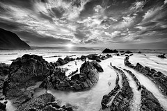 The Tail of the Lizard (CResende) Tags: sunset bw seascape beach bay spain rocks tail lizard barrika biscay cresende northphototours