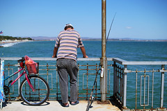 Passing time (manozi) Tags: sea summer sky man beach water bike bicycle fishing fisherman f14 horizon sigma shore burgas blacksea 30mm
