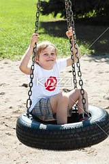 cute elementary boy sitting on tyre swing (kristpeople2012) Tags: park boy portrait cute male grass childhood smiling fun outdoors photography holding day sitting child joy fulllength adorable lifestyle happiness sunny swing innocence daytime freetime enjoyment tyre gripping caucasian sparetime toothysmile casualclothing colorimage lookingatcamera leisureactivity tyreswing oneboyonly 67years elementaryage