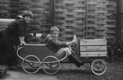 Now that's what you call a Go-Cart (theirhistory) Tags: boy girl grass fruit yard fence garden toy glasses israel child jean boots earth trolley coat wheels case jaffa jacket specs grapefruit hood wellies breeches jodhpurs sixwheeler
