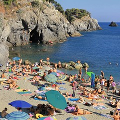 Afternoon delight at the public beach of Montorosso al Mare (Bn) Tags: travel family blue sea summer vacation italy baby holiday hot beach water colors sunshine swimming magazine children fun coast la seaside italian sand topf50 rocks mediterranean italia day mare afternoon locals play liguria families joy group relaxing traditions down tourist tourists line resort busy delight parasol grandparents towels cinqueterre bathing activity lying popular quaint monterosso sunbathing pleasure adriatic sunbather crowded cooling booking jammed sunbeds overrun 50faves