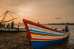 Chinese Fishing Nets :: Fort Cochin (Ragstatic) Tags: travel light sunset india color water boats fisherman god country kerala ng nets fortcochin godsowncountry