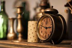 Time is Tickin' into Bokeh (icemanphotos) Tags: clock stilllife bokeh candle bottle old ring copper light naturallight ledge icemanphotos canon