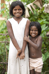 Kid sister grinner (Photosightfaces) Tags: girls girl smile smiling kids sisters happy sister young sri lanka grin grinning lankan grinners seenigama sinigama