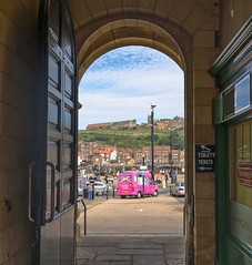 The holiday starts here..... (jack cousin) Tags: nikon d610 on1photos arch archway doorway door icecreamvan buildings hill people tourists tourism travel holiday dayout