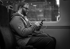 2016_269 (Chilanga Cement) Tags: fuji fujix100t x100t x100s x100 bw blackandwhite music glasses spectacles preston station commuter commuters commuting headphones beard