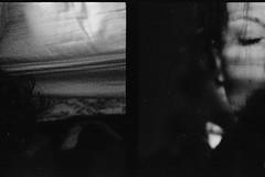 (Abby Billington) Tags: light portrait blackandwhite bw sun white black slr eye film girl face self 35mm 50mm bed diptych asahi pentax k1000 grain oops analogue f18 accidental