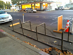 0047 On-street bicycle parking on Main St. at 8th St. in front of Pullins Cyclery (geekstinkbreath) Tags: parking chico bikeracks corral bicycleracks bikeparking bicycleparking bikecorral onstreetbikeparking onstreetbicycleparking bicyclecorral bicycleparkingcorral bikeparkingcorral htcamaze4g