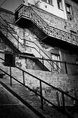 Budapest, Hungary (Stacy Johnson 1) Tags: world door travel vacation blackandwhite white holiday abstract black building brick window stone wall stairs fence bars europe hungary budapest steps rail plaster banister railing derelict buda