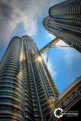 PETRONAS Twin Towers (Tareq Abuhajjaj | Photography & Design) Tags: light sky white black speed dark photography lights design photo high nice nikon flickr power natural top dream ferrari malaysia saudi kuala fiber riyadh v8 lumpur  2010 ksa tareq    kualalumpurcitycentre    d700  federalterritoryofkualalumpur tareqmoon  abuhajjaj  50088kualalumpur