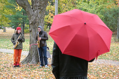 Sax In The Rain (peterkelly) Tags: autumn red musician music ontario canada tree fall leaves digital umbrella concert community guelph northamerica sax saxophone exhibitionpark encarnado scottthomson theshare musagetes susannahood