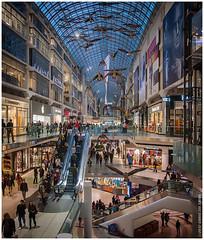 Eaton Centre (Chris Lue Shing) Tags: city people toronto ontario canada shop mall shopping evening geese twilight downtown elevator escalators stores eatoncentre olympusep1 panasonic14mmf25asph chrislueshing
