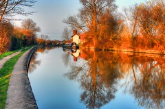 Grand Union Canal at Sunset (john edward michael1) Tags: trees sunset england nature clouds canon reflections landscape boats canal beds buckinghamshire bluesky aylesbury tring bucks hdr leightonbuzzard grandunioncanal waterways cottages ivinghoe narrowboats pitstone aylesburyvale marsworth bulbourne eos450d goldstaraward mygearandme