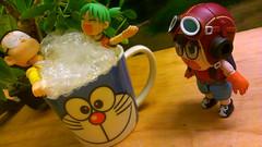 Surprise! (John 3000) Tags: anime cup moblog comics phonecam toys bath funny cartoon manga bubbles deck actionfigures hottub surprise bubble mug doraemon characters akira spa taza fujiko juguetes koiwai nobita  norimaki azuma nobi arale drsl
