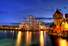Magic (Rickydavid) Tags: lake castle night reflections lago magic rollercoaster riflessi magia parcogiochi montagnerusse rickydavid riccardocuppini rainbowmagicland flickrstruereflection6 flickrstruereflectionexcellence pwpartlycloudy wwwriccardocuppinicom httpwwwfacebookcomriccardocuppiniphotography