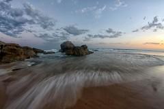 Tidal (pominoz) Tags: sunset sea beach clouds newcastle rocks waves fisheye redhead nsw redheadbeach