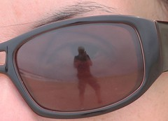 A traves de tu mirada (carlos_ar2000) Tags: distortion reflection eye beach me uruguay ojo glasses photographer yo playa reflected reflejo gafas mirada glance lentes fotografo distorsion rocha puntadeldiablo i