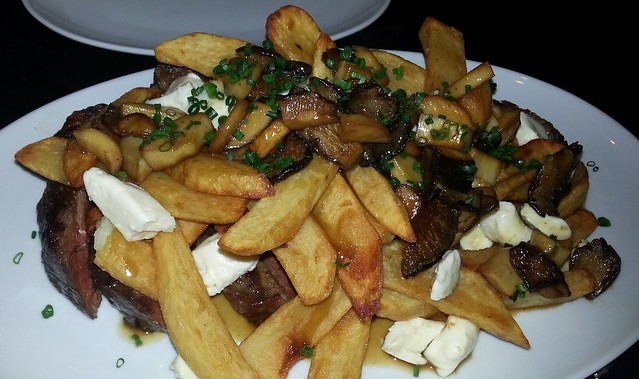 26 oz Steak with Oyster Mushrooms and Poutine at Restaurant Biarritz