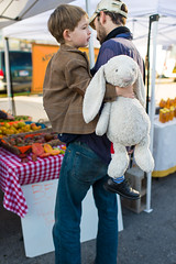 Hanging on at the Farmers Market (-Dons) Tags: boy usa man rabbit austin texas unitedstates tx father stuffedanimal austinfarmersmarket stuffedrabbit