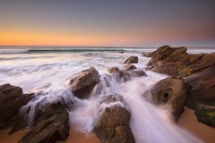 Over the Rocks (Paul Hollins) Tags: aus australia newsouthwales redhead nikond750 nikon1635mmf4 seascape rocks ocean shore sand watermovement