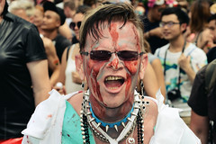 """Here I am"" (domenicocarusophoto) Tags: feelings strong red face pride parade painted enjoying fun proud gayparade facepaint redface colors neckless earrings sunglasses man people csd gaypride berlin expression manifest freedom power studs metal"