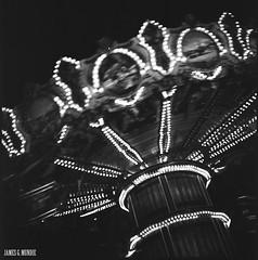 Swing carousel (James Mundie) Tags: jamesmundie jamesgmundie profjasmundie jimmundie mundie copyrightjamesgmundieallrightsreserved copyrightprotected blackandwhite blancetnoir noir black monochrome monochromatic bw blancoynegro biancoenero schwarzweis mediumformat squareformat 120mm 120film 6x6 film analog yashicaa mittelformat tlr twinlensreflex carousel palaceplaylandamusementpark old orchard beach oldorchardme maine downeast