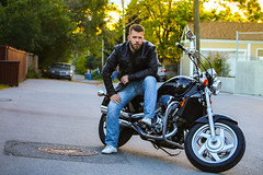 Bad boy (Joshua Hansen) Tags: bike motorcycle alley motorbike biker man sexy pensive beard jeans honda magna 750 leather jacket pipes portrait tripod canon70d evening fall natural image light life sunlight sunplay trees fences badboys