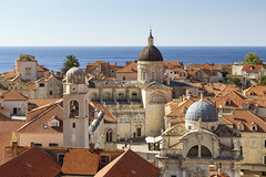 Dubrovnik (Voyages Lambert) Tags: rooftile clearsky buildingexterior stonematerial oldtown medieval history red blue old famousplace architecture traveldestinations outdoors horizontal highangleview dubrovnik croatia day sky roof cathedral church tower urbanskyline cityscape city