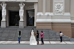 Preparing the bride (Roving I) Tags: sculpture streets art architecture photography steps statues vietnam topless brides marble weddings pillars hochiminhcity hcmc brideandgroom operahouses bridalcouples