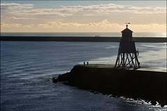 the groyne lighthouse (heavenuphere) Tags: uk travel sea england people lighthouse silhouette newcastle outdoors pier seaside unitedkingdom tyne coastal northsea waving southshields groyne herd tyneandwear traveldestinations 55250mm