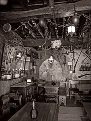 Challenge: spot something I haven't noticed! (Una S) Tags: old portugal bar mirror place chairs bottles ceiling busy tables hanging obidos hook