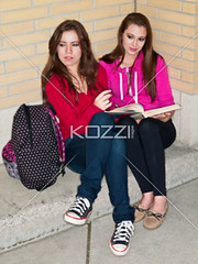 beautiful teenage girls looking away while studying (elisapeople2012) Tags: friends girl beautiful beauty modern female bag reading book togetherness student education pretty sitting friendship fulllength teenagers highschool learning companion studying twopeople casualwear bonding lookingaway caucasian schoolbag companionship youthculture teenagegirls casualclothing universitystudent 1617years teenagersonly legscrossedatknee onlygirls personineducation teenagegirlsonly