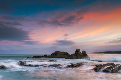 Port Waikato Glow (Nick Twyford) Tags: sea newzealand seascape colour water sunrise nikon rocks waves auckland northisland westcoast portwaikato leefilters 1024mm d7000 lee06gndhard lee12gndhard