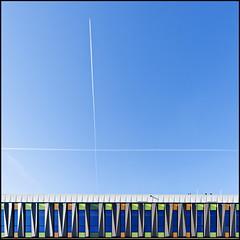 Sky crossing (Maerten Prins) Tags: blue windows sky orange abstract building green colors lines modern plane nijmegen airplane colours cross x trail chemtrail heinz retestrak