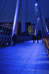 Hunger March (The New Motive Power) Tags: city bridge blue people urban london thames modern buildings river dark walking evening design quiet crossing footbridge dusk centre perspective pedestrian structure southbank hungerford convergence distance canon7d