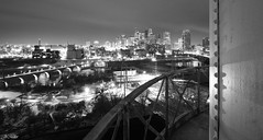 Minneapolis, Minnesota (Mr. Moment) Tags: city longexposure bridge roof sky urban blackandwhite bw usa moon building classic mill abandoned rooftop minnesota skyline night america skyscraper canon wow river dark landscape photography lights blackwhite insane downtown cityscape view skyscrapers unitedstates awesome watertower cities minneapolis wideangle panoramic structure fresh historic dude explore urbanexploration waterfalls citylights infrastructure mississippiriver twincities exploration tamron skyscaper ue t3i stanthony urbex citylight 10mm statehospital stonearchbridge stanthonyfalls minneapolisminnesota stanthonymain justinmiller minneapolisskyline